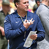 (Brad Davis/The Register-Herald) West Virginia head coach Dana Holgorsen calls plays hand signals during the Mountaineers' Gold-Blue Spring football game Saturday afternoon at The Greenbrier.