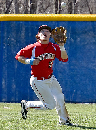 (Brad Davis/The Register-Herald) Independence outfielder Chris Mills runs down a fly ball during the Patriots' win over Shady Spring Saturday afternoon in Coal City.