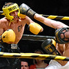 (Brad Davis/The Register-Herald) Brandon Hendricks, right, lands a shot on Robert Laughery during Saturday's Original Toughman Contest action at the Beckley-Raleigh County Convention Center.