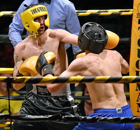 (Brad Davis/The Register-Herald) Michael Suttle, right, takes on Timothy VanBuskirk during Saturday's Original Toughman Contest action at the Beckley-Raleigh County Convention Center.