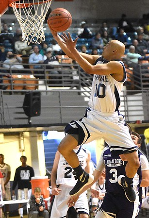 Jeremy Thompson, of Bluefield, playing for Jan-Care AA all-stars goes in for a layup against the C. Adam Toney Class A all-stars, during the Little General Scott Brown Classic held at the Beckley-Raleigh County Convention Center Saturday evening.<br /> (Rick Barbero/The Register-Herald)