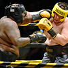 (Brad Davis/The Register-Herald) Gary Edwards, left, takes on Leland McClanahan during Saturday's Original Toughman Contest action at the Beckley-Raleigh County Convention Center.