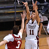 (Brad Davis/The Register-Herald) Team Crossroads' Tavian Dunn-Martin shoots from three-point range during the second game of the Scott Brown Classic Saturday night at the Beckley-Raleigh County Convention Center.