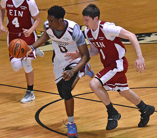 (Brad Davis/The Register-Herald) Team Crossroads' Harold Baruti hustles up the court as Team EIN's Steven Solomon chases during the second game of the Scott Brown Classic Saturday night at the Beckley-Raleigh County Convention Center.