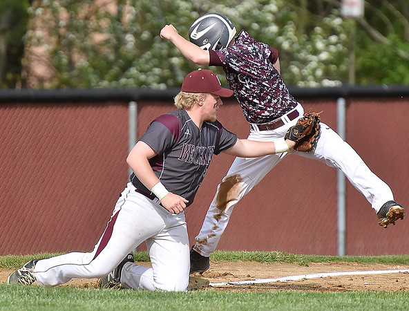 (Brad Davis/The Register-Herald) Woodrow Wilson third baseman Cameron Pack puts the tag on George Washington's Jacob Robinson, right, after he unsuccesfully tried to dance around attempting to steal during the Flying Eagles' loss to the Patriots Friday afternoon in Beckley.