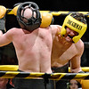 (Brad Davis/The Register-Herald) John Brooks, right, lands a right on Randy Ferrill during Saturday's Original Toughman Contest action at the Beckley-Raleigh County Convention Center.