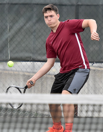 (Brad Davis/The Register-Herald) Bluefield's Zach Springman plays in a doubles match against Woodrow Wilson Wednesday afternoon in Beckley.