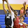 (Brad Davis/The Register-Herald) Team Crucial's (Beckley) Jonah Stevens, right, battles for a rebound with Westside's (Clear Fork) Caleb Walls during a 8th grade matchup in the Spring Fling Tournament Sunday afternoon at Shady Spring High School. Team Crucial won the game 47-39.