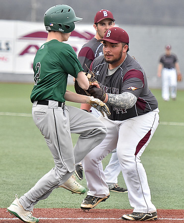 (Brad Davis/The Register-Herald) Woodrow Wilson's Bradley Pack steps up and tags Fayetteville's C.J. Dooley on his way to first during the Flying Eagles' win over the Pirates Thursday afternoon at Linda K. Epling Stadium.