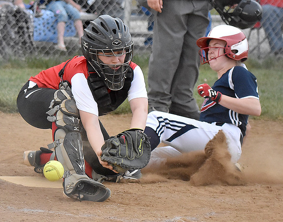 (Brad Davis/The Register-Herald) Liberty catcher Madison Stone reaches to try and catch a wide throw as Independence's Riley Adkins slides home to score a run during the Patriots' win over the Raiders Thursday evening in Glen Daniel.