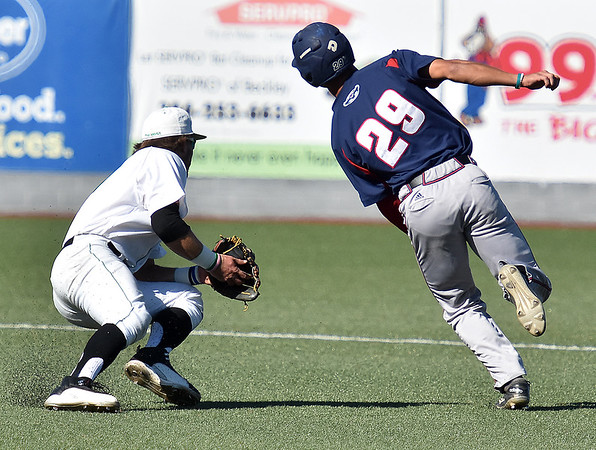 (Brad Davis/The Register-Herald) Florida Atlantic's Billy Endris eludes Marshall infielder Aaron Bossi, left, after get picked off and caught in a rundown between first and second before eventually diving safely into second, then being tagged out on a baserunning mistake Saturday afternoon at Linda K. Epling Stadium.