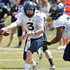 (Brad Davis/The Register-Herald) West Virginia quarterback Skyler Howard hands off to running back Rushel Shell during the Mountaineers' Gold-Blue Spring football game Saturday afternoon at The Greenbrier.