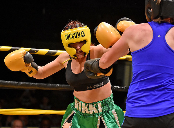 (Brad Davis/The Register-Herald) Nikki Green, left, takes on Sarah Coffey during Toughman Contest action Friday night at the Beckley-Raleigh County Convention Center.
