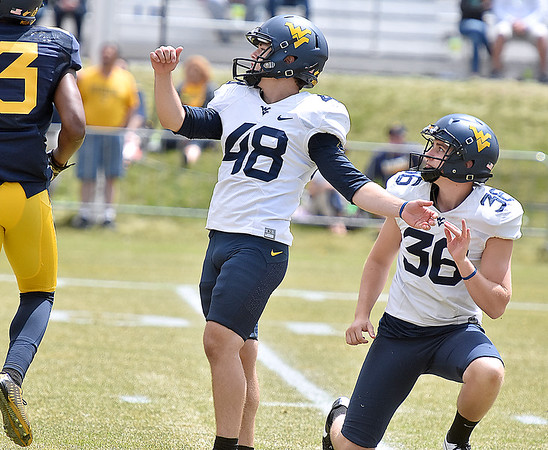 (Brad Davis/The Register-Herald) West Virginia kicker Mike Molina kicks during the Mountaineers' Gold-Blue Spring football game Saturday afternoon at The Greenbrier.