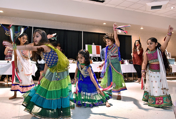 (Brad Davis/The Register-Herald) A group of young dancers dressed to the culture perform an Indian style routine during the YMCA International Dinner Sunday afternoon at the Beckley-Raleigh County Convention Center.