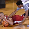 Depaul commit Levi Cook, left, dives on a loose ball before Team Crossroads Chevy's (Class AAA) Harold Baruti can during Team EIN's (national) win in the second game of the Scott Brown Classic Saturday night at the Beckley-Raleigh County Convention Center.