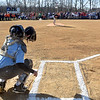 (Brad Davis/The Register-Herald) Shady Ice (Major Softball Division) catcher Alyssa Lilly, lower left, reaches out to catch Orioles (Major Baseball Divison) team member Matthew McPeak's ceremonial first pitch as hundreds of players and their coaches line the infield behind them during Shady Spring Little League Opening Day festivities Saturday morning.