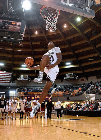(Brad Davis/The Register-Herald) WVU commit Sagaba Konate participates in the dunk contest prior to the second game of the Scott Brown Classic Saturday night at the Beckley-Raleigh County Convention Center.