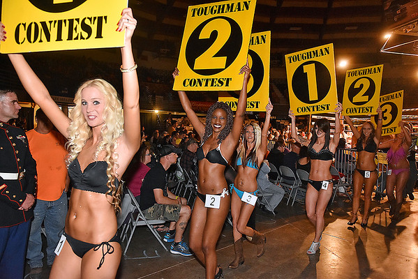 (Brad Davis/The Register-Herald) This year's ring girl lineup parades around the ring during the start of Toughman Contest action Friday night at the Beckley-Raleigh County Convention Center.