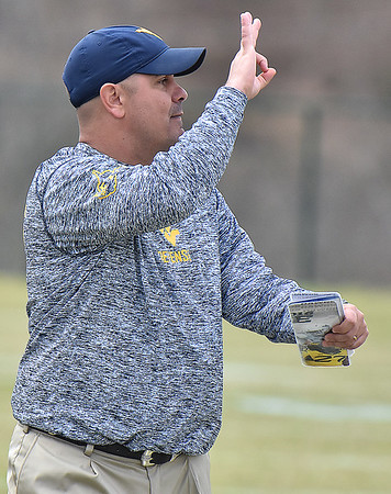 (Brad Davis/The Register-Herald) West Virginia defensive coordinator Tony Gibson calls plays during the Mountaineers' Gold-Blue Spring football game Saturday afternoon at The Greenbrier.