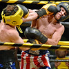 (Brad Davis/The Register-Herald) R.J. Foldon, right, takes on Ryan Rife during Saturday's Original Toughman Contest action at the Beckley-Raleigh County Convention Center.