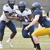 (Brad Davis/The Register-Herald) West Virginia quarterback William Crest Jr. hands off to running back Deonte Glover during the Mountaineers' Gold-Blue Spring football game Saturday afternoon at The Greenbrier.