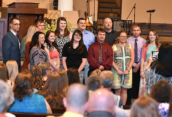 (Brad Davis/The Register-Herald) University of Charleston-Beckley graduates of the Radiologic Technology Program Following a ceremony Friday night at Calvary Assembly of God. UC-Beckley's School of Health Sciences sent off its 2016 graduates from their Occupational Therapy Assistant and Radiologic Technology programs with a special pinning ceremony at the Sunset Drive church.