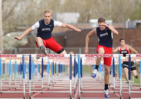 Austin Weiss, left, and Jared Hunt from Independence, compete in the hurdles  during a track meet at Independence in Coal City on Tuesday. (Chris Jackson/The Register-Herald)