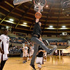 (Brad Davis/The Register-Herald) Matt Morris makes sure to throw down a dunk of his own prior to the second game of the Scott Brown Classic Saturday night at the Beckley-Raleigh County Convention Center.