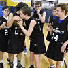 (Brad Davis/The Register-Herald) WV Warriors' Luke Thompson leans in to kiss the trophy after he and his team defeated Shady Spring Elite to take the 7th grade Spring Fling Tournament WV Warriors went on to win the game.
