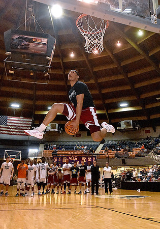(Brad Davis/The Register-Herald) Morgantown's Kenzie Melko (National Team EIN) goes airborne as he participates in dunk contest prior to the second game of the Scott Brown Classic Saturday night at the Beckley-Raleigh County Convention Center.