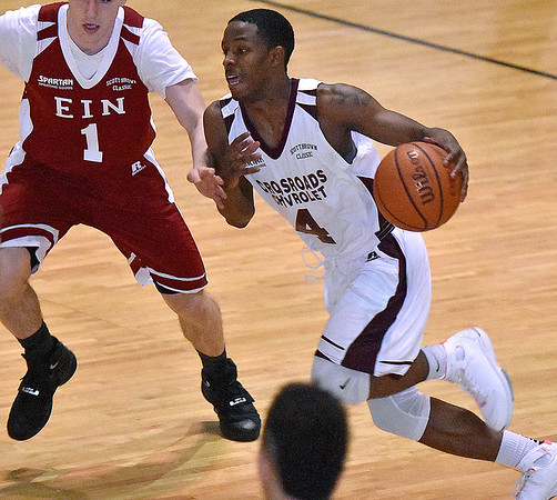 (Brad Davis/The Register-Herald) WVU commit Brandon Knapper drives during Team EIN's (national) win over Team Crossroads Chevy (Class AAA) in the second game of the Scott Brown Classic Saturday night at the Beckley-Raleigh County Convention Center.