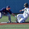 (Brad Davis/The Register-Herald) Marshall's Leo Valenti is tagged out on a steal attempt by Florida Atlantic third baseman Austin Langham after a botched hit and run play Saturday afternoon at Linda K. Epling Stadium.