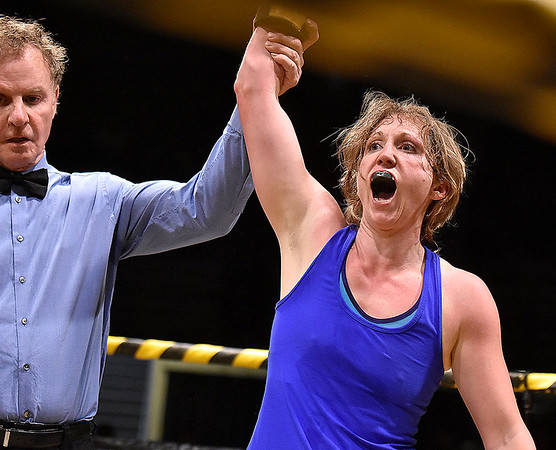 (Brad Davis/The Register-Herald) Sarah Coffey reacts as she's declared the winner of her match against former champ Nikki Green during Toughman Contest action Friday night at the Beckley-Raleigh County Convention Center.