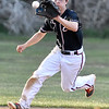 (Brad Davis/The Register-Herald) Greater Beckley Christian shortstop Tanner Ray fields a ground ball during the Crusaders' win over Man Thursday evening.