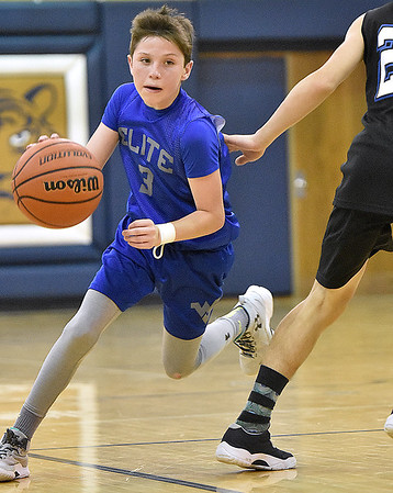 (Brad Davis/The Register-Herald) Shady Elite's Todd Duncan drives against WV Warriors (Charleston) during the 7th grade Spring Fling Tournament championship game Sunday afternoon at Shady Spring High School. WV Warriors went on to win the game.
