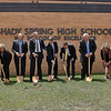 (Brad Davis/The Register-Herald) A gathering of school administrators, local leaders and state and local board of education officials get their ceremonial shovels dirty as they break ground on an upcoming round of upgrades and renovations at Shady Spring High School Wednesday afternoon.