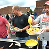 Jeremy Hart, left, Jamie Bolen and Bill Spurlock, working the outdoor concession for a fund raiser for the wrestling team during the Independence vs Pikeview football game Friday night on George D Covey Field at Independence High School.<br /> (Rick Barbero/The Register-Herald)