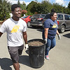 Ayooluwa Oni, left, and Samar Ramirez, WV Tech students Montgomery campus, helps cleanup the Midland Trail Park off of Main Street in White Sulphur Springs.<br /> (Rick Barbero/The Register-Herlad)
