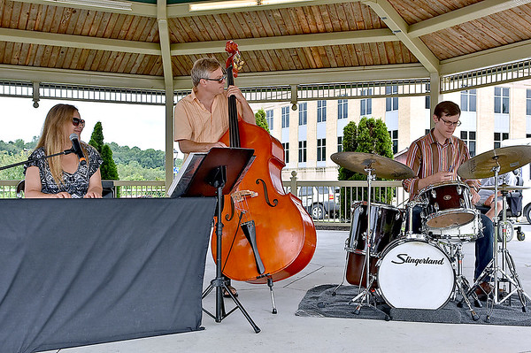 (Brad Davis/The Register-Herald) The Morgantown-based Jenny Wilson Trio performs as part of this year's Simply Jazz & Blues Festival during Friday's in the Park underneath the gazebo at Jim Word Memorial Park yesterday afternoon.