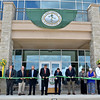 (Brad Davis/The Register-Herald) An army of state and local leaders, community members and school administrators cut the ceremonial ribbon as they open up the Student Center on the campus of the West Virginia School of Osteopathic Medicine Friday afternoon in Lewisburg.