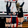 Meadow Bridge's Micah Farr (14) and Kaylie Persinger (5) prepare to block a strike from Liberty's Tabitha Richardson (5) during their match Tuesday at Oak Hill. (Chris Jackson/The Register-Herald)