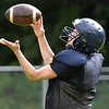 (Brad Davis/The Register-Herald) Cavaliers receiver Logan Seldomridge hauls in a pass during practice Friday afternoon at Greenbrier West High School in Charmco.