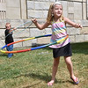 (Brad Davis/The Register-Herald) Six-year-old Krista Marshall and five-year-old Levi Wood spend some time honing their hula hoop skills at the Active Southern West Virginia booth during the Kids Classic Festival Saturday.
