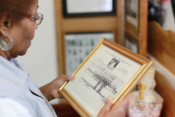 Gilberta Taylor Patterson looks over old photos of DuBois High School. (Chris Jackson/The Register-Herald)