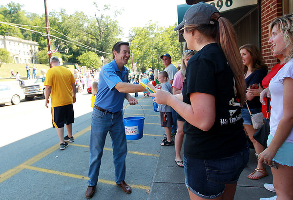 U.S. Congressman Evan Jenkins hands out candy during the annual Pineville Labor Day Parade on Monday. (Chris Jackson/The Register-Herald)