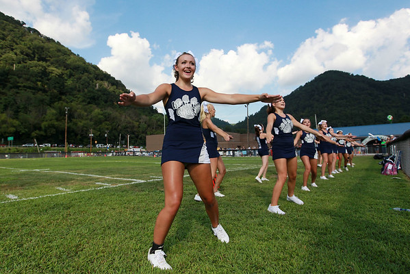 Valley cheerleaders cheer during the first quarter of their <br />  during season opener against Clay-Battelle in Smithers on Friday. (Chris Jackson/The Register-Herald)