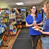 (Brad Davis/The Register-Herald) Owner Sierra Hattier, left, chats with patron Laura Davis at the Lansing General Store, located at 349 Lansing-Edmond Road in Lansing September 3.