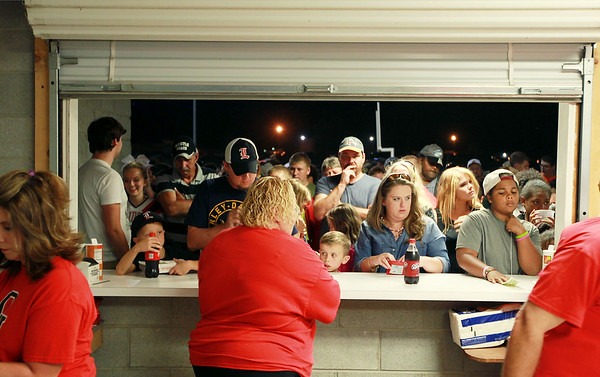 Liberty and Oak Hill fans lineup at the concession for refreshments at halftime of their football game in Oak Hill on Friday. (Chris Jackson/The Register-Herald)