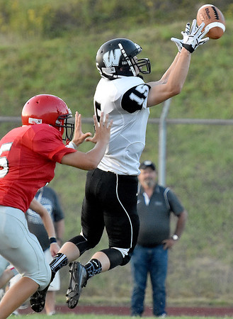 (Brad Davis/The Register-Herald) Westside's Jacob Ellis makes a catch against Liberty Friday night in Glen Daniel.